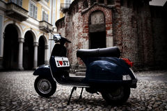 Vintage italian scooter. Vintage Vespa in front of monuments in my town royalty free stock image