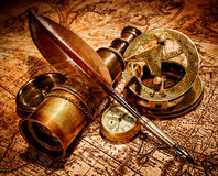 Vintage items on ancient map. Stock Image