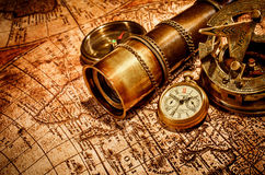 Vintage items on ancient map. royalty free stock photography