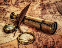 Vintage items on ancient map. Stock Images