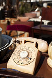 Vintage Telephone. Vintage ivory colored dial telephone in display for sale at the flee market in Jaffa, Israel Stock Photo