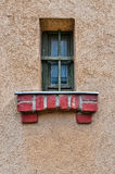 Vintage Jail Window. Small jail window with bars forming a cross in a prison wall royalty free stock image