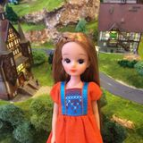 An adorable vintage doll named Licca-chan is standing alone. The vintage Japanese doll is so cute and lovely. The background is cute miniature town. Cutest toy royalty free stock images