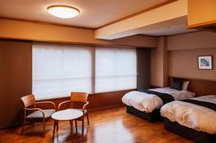 Vintage Japanese hotel bedroom with sliding doors, wood table an royalty free stock photography