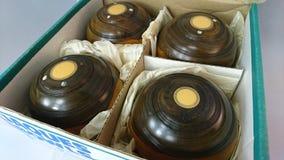 Vintage jaques wooden lawn bowls stock image