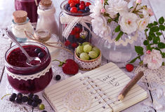 Vintage jar with jam, fresh berries and notebook with text love you stock images