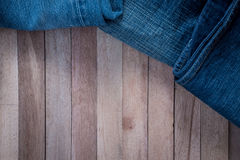 Vintage Jean on wooden background Stock Photography