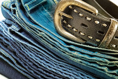 Vintage jeans and leather belt Stock Photography
