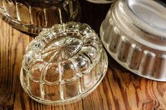 Vintage Jelly Moulds. Old fashioned glass and aluminum jelly or blancmange moulds for making traditional jellies royalty free stock photo