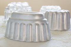 Vintage Jelly Moulds. Vintage aluminum and glass jelly or blancmange moulds for making traditional jellies stock image