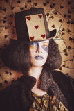 Vintage jester woman wearing the card of hearts Royalty Free Stock Photos
