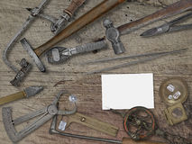 Vintage jeweler tools over wooden bench Royalty Free Stock Images