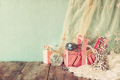 Vintage jewelery , antique wooden jewelery box and perfume bottle on wooden table. filtered image Stock Images