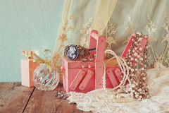 Vintage jewelery , antique wooden jewelery box and perfume bottle on wooden table. filtered image Royalty Free Stock Photography