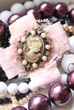 Vintage jewelry. Vintage background with beautiful brooch and beads Royalty Free Stock Photo