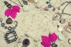Vintage jewelry on a textured background toned. Vintage jewelry on a textured background. Top view flay stock images