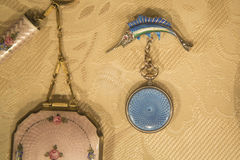 Vintage Jewelry. Victorian Era jewelry displayed on a buff colored cloth stock photos