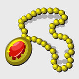Vintage jewelry with yellow beads and red pendant Royalty Free Stock Photo