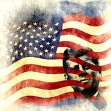 Vintage John F. Kennedy background. Grunge background with the iconic figure of President John F. Kennedy and the US flag Stock Photography
