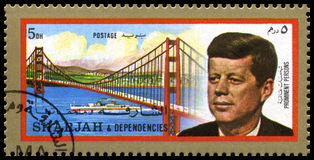 Vintage John F Kennedy Postage stamp from Sharjah. SHARJAH, CIRCA 1972: A Postage Stamp from Sharjah showing a portrait of former President of the United States stock photos