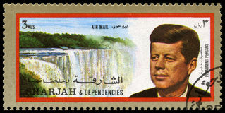 Vintage John F Kennedy Postage stamp from Sharjah. SHARJAH, CIRCA 1972: A Postage Stamp from Sharjah showing a portrait of former President of the United States Royalty Free Stock Images