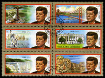 Vintage John F Kennedy Postage stamps from Sharjah. SHARJAH, CIRCA 1972: A set of Postage Stamps from Sharjah each showing a portrait of former President of the royalty free stock image