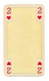 Vintage jouant la carte avec le fond de coeurs Photographie stock libre de droits