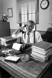 Vintage journalist on the phone Stock Photography
