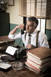 Vintage journalist on the phone stock images