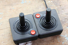 Vintage joystick. For controller and playing video game on rustic wooden background stock images