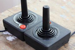 Vintage joystick. For controller and playing video game on rustic wooden background stock photo