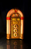 Vintage jukebox with reflection on black Royalty Free Stock Images