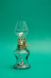 Vintage kerosene lamp on green background Royalty Free Stock Photos