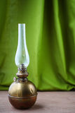 Vintage kerosene lamp on a green background Royalty Free Stock Photos