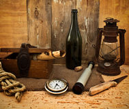 Vintage kerosene lamp, spyglass and a bottle Stock Photo
