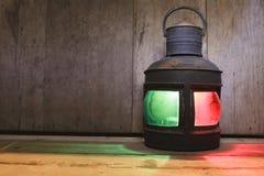 Vintage kerosene oil lantern on wooden floor Royalty Free Stock Photo