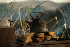 Vintage kettle is on fire. Picnic in the forest. royalty free stock photo