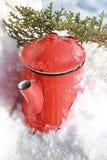 Vintage kettle. Vintage metal retro red kettle, snow background, vintage image Royalty Free Stock Images