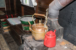 Vintage Kettle on old stove in Gypsy Caravan Stock Images