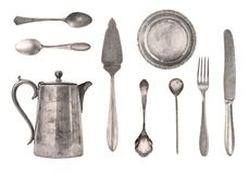 Vintage kettle, spoons, forks, knives and plate isolated on white background. Antique silverware. Retro royalty free stock photography