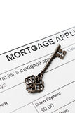 Vintage key against mortgage agreement Stock Photo