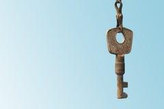 Vintage key on blue background. Copy space Stock Photography