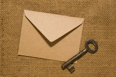 Vintage key and envelope on old cloth Royalty Free Stock Photography