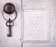 Vintage key hanging on a vintage door