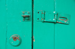 Vintage key hold and unlocked door royalty free stock photography