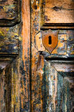 Vintage key hole on weathered wooden door Royalty Free Stock Photos