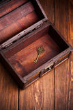 Vintage key inside old treasure chest Royalty Free Stock Images