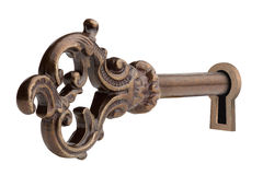 Vintage key in keyhole. Vintage key in keyhole, isolated on the white background, clipping path included Stock Photos