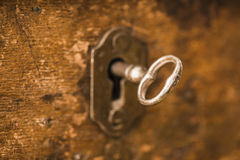 Vintage key in lock of wooden chest Stock Images