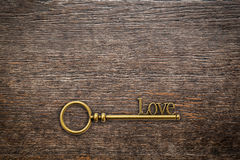 Vintage key for love on wood background with space. Valentine Stock Image
